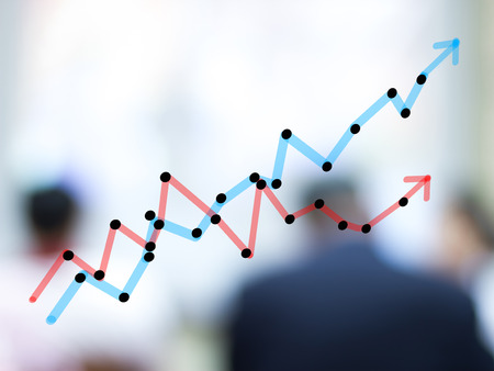 growth bar chart with blurred business people background photo