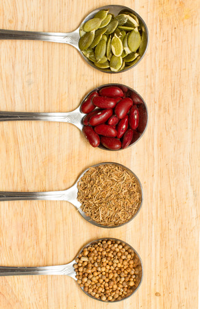 collection of various food ingredients in spoon photo