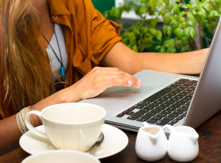 Girl with a cup of coffee and laptop photo