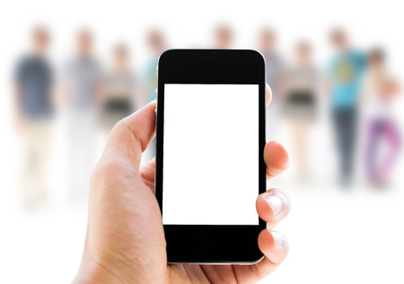 adult texting: hand holding phone on people background Stock Photo