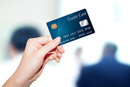 cash card: female  hand holding credit card