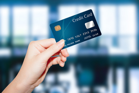 debit card: female  hand holding credit card
