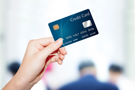 business card in hand: female  hand holding credit card