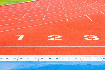 one lane: Running track numbers one two three in stadium Stock Photo