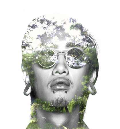 multiple exposure: Double exposure of asian guy with glasses and nature Stock Photo