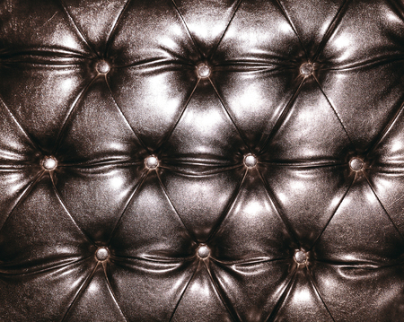 Luxurious brown color leather texture furniture with buttons, upholstery photo
