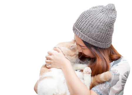 Cute young woman kiss cute cat isolated on white background photo