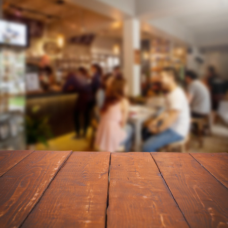 focus on: Empty table and blurred people in cafe background, product display Stock Photo