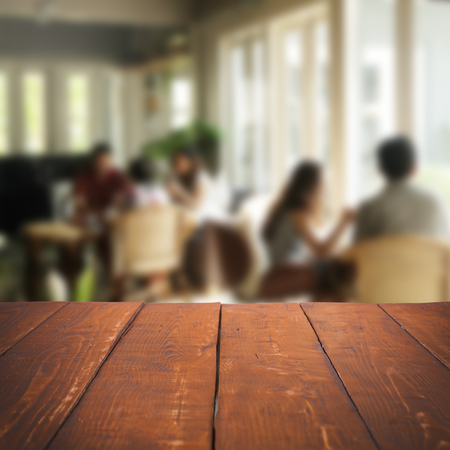 wooden deck: Empty table and blurred people in cafe background, product display Stock Photo