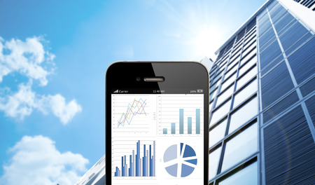 close up smart phone against business building with blue sky background