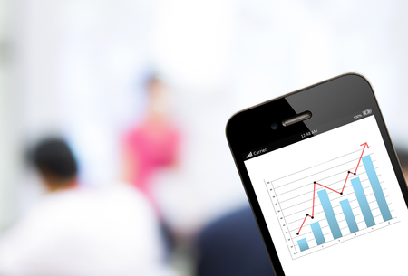 financial planning: close up  mobile phone with analyzing graph Stock Photo