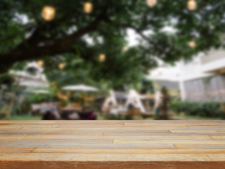 Empty wooden table and blurred outdoor cafe backgroundproduct display