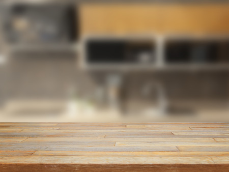 background wood: Empty wooden table and blurred kitchen background product display