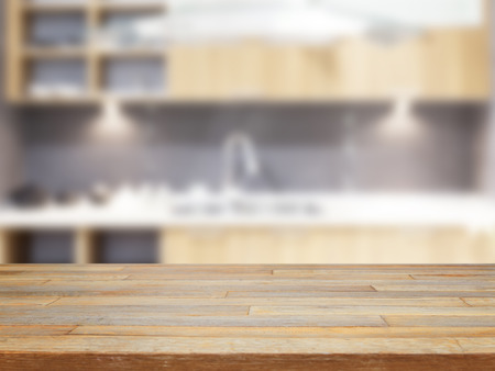 empty surface: Empty wooden table and blurred kitchen background product display