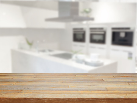 new kitchen room: Empty wooden table and blurred kitchen background product display