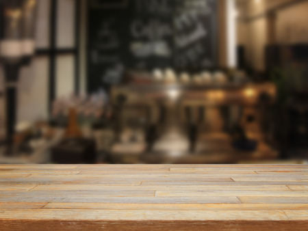 Empty wooden table and blurred cafe backgroundproduct display