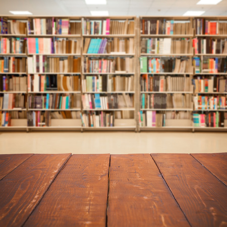 old library: Empty wooden table and modern library background, product display Stock Photo