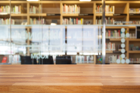 Empty wooden table and modern library background, product display Foto de archivo