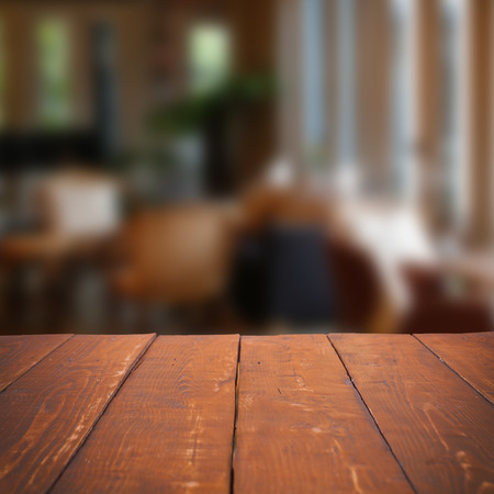 Empty wooden table and blurred cafe background,product display