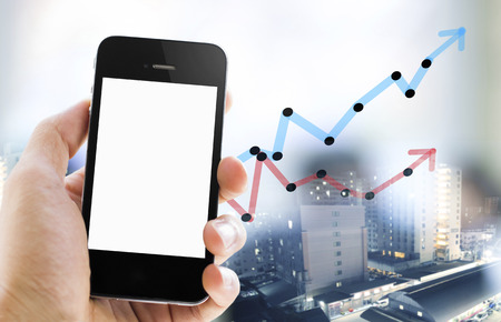 Close-up hand holding smart phone with business graph and double exposure background