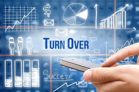 turn over: Hand holding smart phone with drawing business plan concept,mobile strategy, Turn Over word Stock Photo