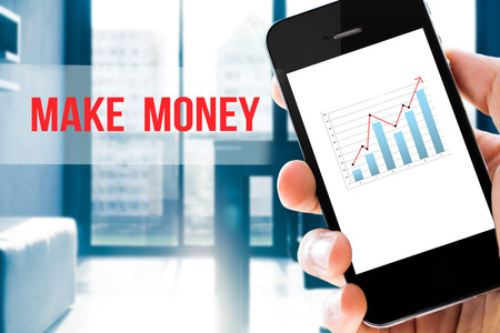 business report: Closeup hand holding mobile phone show analyzing graph with conference room background ,make money word