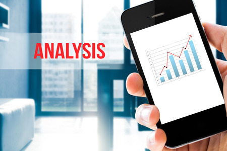 intelligence: Closeup hand holding mobile phone show analyzing graph with conference room background ,Analysis word