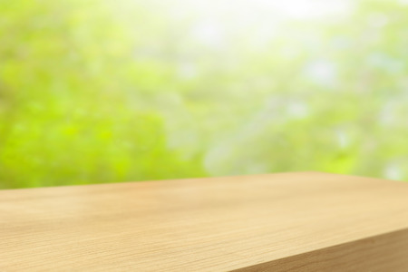 foliage: Empty wooden table and green natural spring blur bokeh background , product display montage Stock Photo