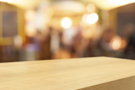 wood product: Empty wooden table and blurred cafe background, product display montage