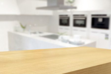 empty surface: Empty wooden table and blurred kitchen background, product display