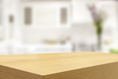 place of living: Empty wooden table and blurred kitchen background, product display montage