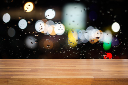 copy sapce: Empty wooden table with colorful  night light bokeh circle shape background. product montage display Stock Photo