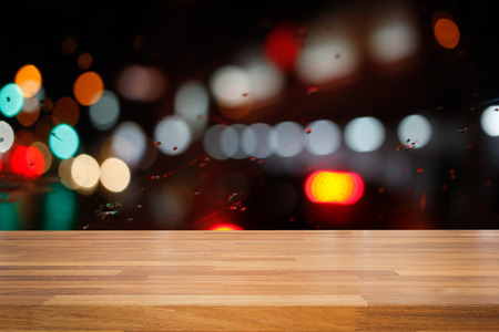 street night: Empty wooden table with colorful  night light bokeh circle shape background. product montage display Stock Photo