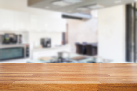 kitchen counter: Empty wooden table and blurred kitchen background, product  montage display