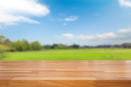 finite: Empty table and field of grass and perfect sky background,  product display montage
