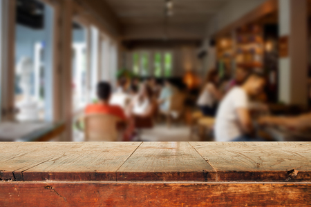product: Empty wooden table and blurred people in cafe background, product display montage