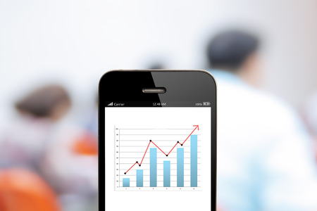 growth business: close up  mobile phone with analyzing graph,planing,business success