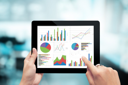 Closeup hand holding digital tablet show analyzing graph,planing,business success