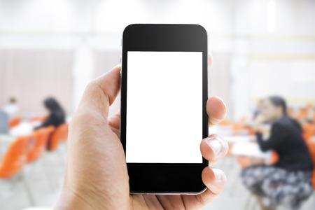 hand hold: Close up of hands man holding smart phone with blank screen on blurred people background