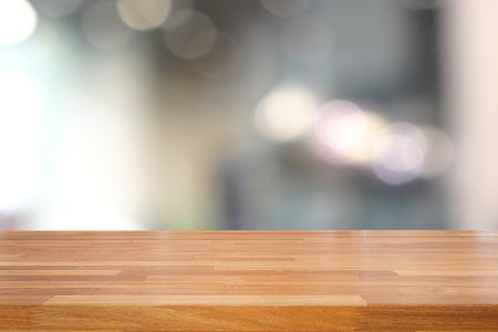 background brown: Empty wooden table and blurred kitchen background, product montage display
