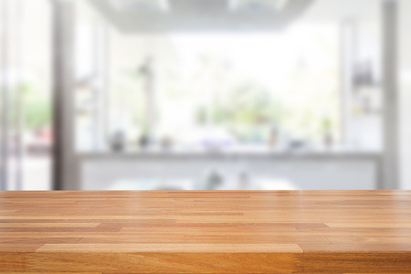 domestic kitchen: Empty wooden table and blurred kitchen background, product montage display