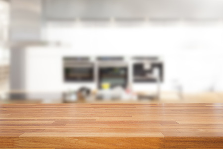 empty table: Empty wooden table and blurred kitchen background, product montage display