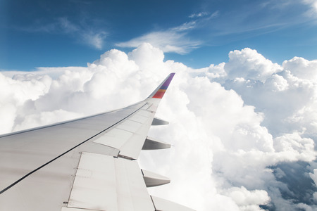 plane: Wing of the plane on blue sky background
