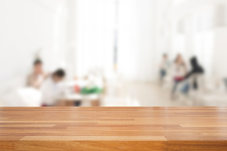 empty of people: Empty wooden table and blurred people in cafe background, product display.Ready for product montage