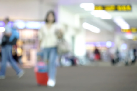 Blurred diverse passengers with luggage waiting  at airport boarding. Blurry  travelers walking. Standard-Bild - 110441641