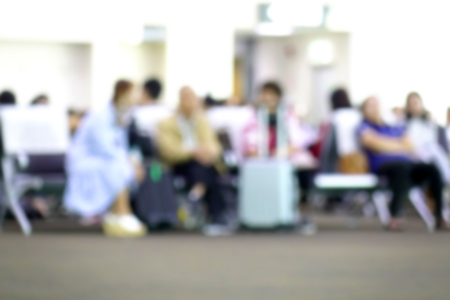 Blurred diverse passengers with luggage waiting  at airport boarding. Blurry  travelers sitting. Standard-Bild - 110441642