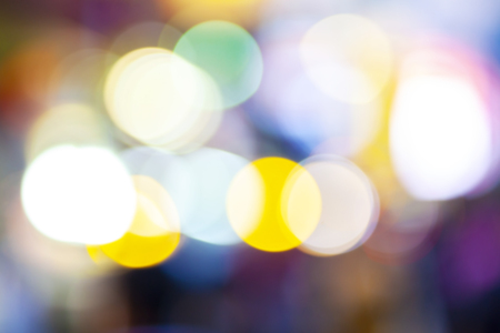 City lights abstract circular bokeh with blue color sunset, blurry building and street nightlife, abstract background Standard-Bild - 110441647