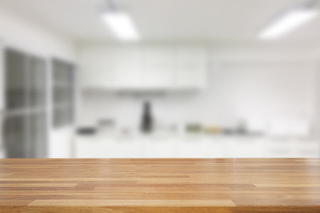 Empty wooden and table on abstract white modern kitchen background with shelf, product display, Ready for product montage Standard-Bild - 126589899