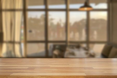 Empty wooden table and blurred modern  kitchen coffee cafe background with windows, restaurants. Ready for product montage, bokeh , warm light Standard-Bild - 126589907