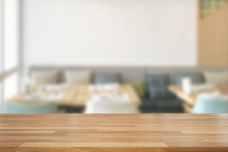 Empty wooden table and blurred modern white kitchen coffee cafe background, restaurants. Ready for product montage, bokeh , light Standard-Bild - 126589910
